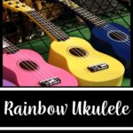 """A picture of four ukuleles laying flat for sale at a market. The words on the image read """"Rainbow Ukulele: Digital Student & Teacher Megabundle"""""""