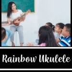 """A picture of a teacher holding a ukulele while sitting on a stool in front of students who are sitting on the ground in a circle. The words on the image read """"Rainbow Ukulele: Digital Teacher Curriculum"""""""